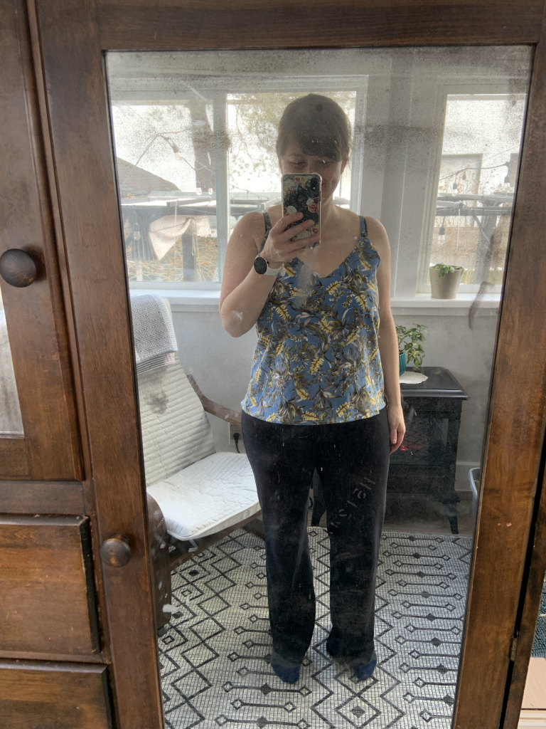 Maker taking a selfie in the mirror of a vintage armoire wearing her finished Ogden Cami by True Bias