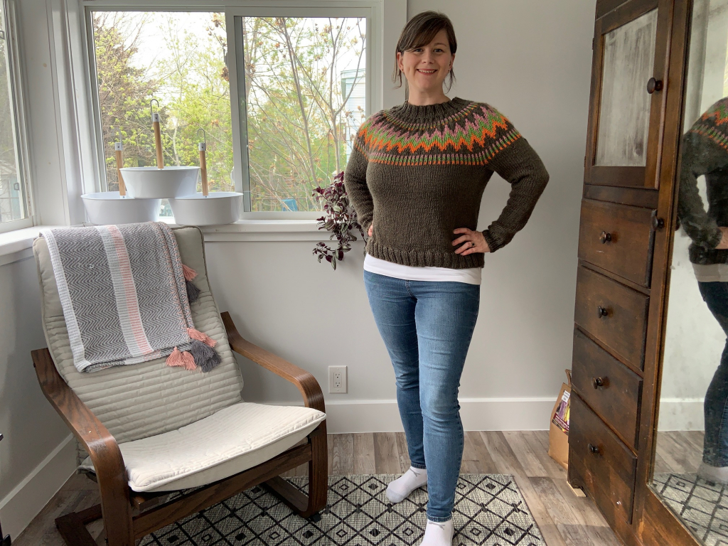 author wearing hand knit sweater