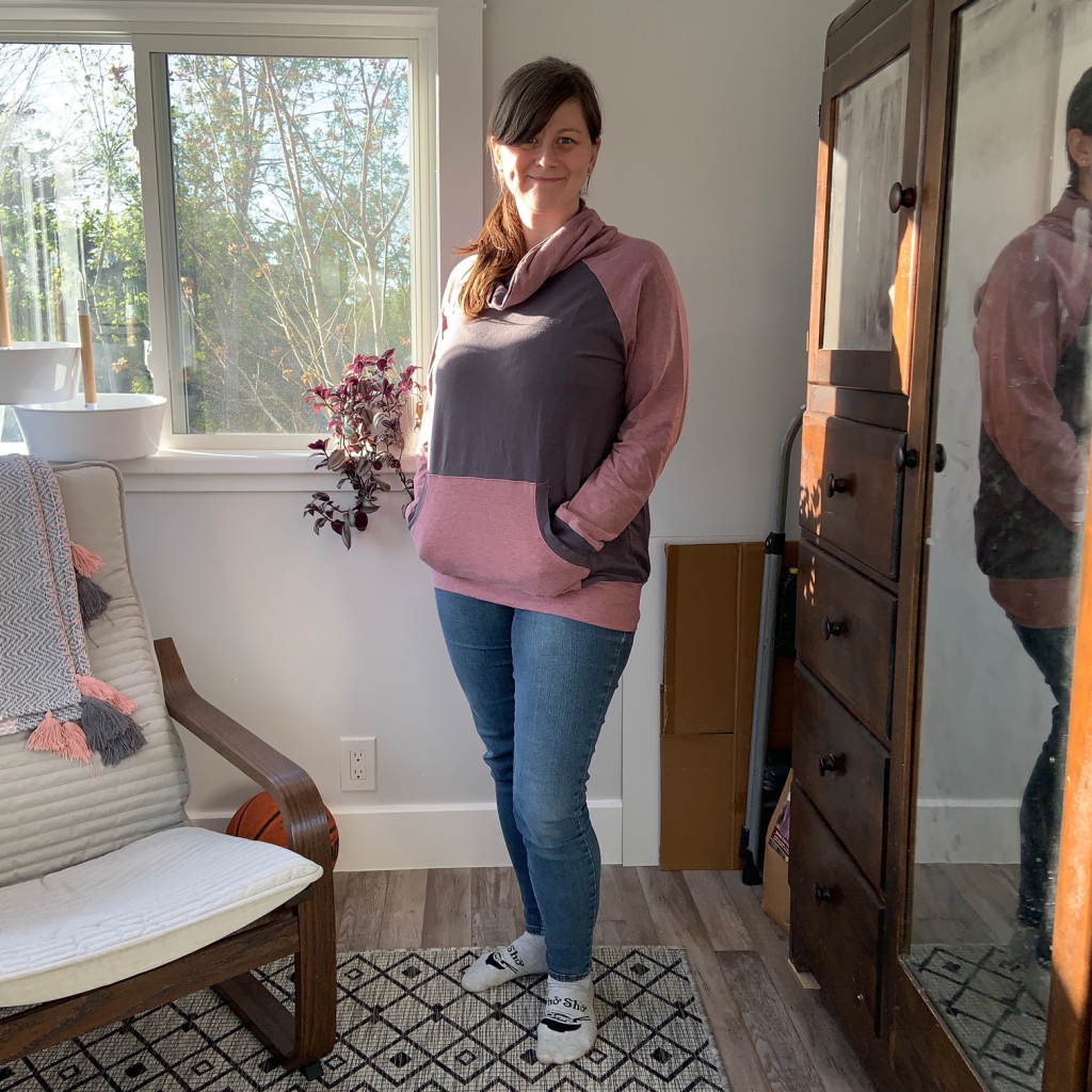 Maker modelling a two toned finished Nova Sweatshirt by Sinclair Patterns made in mauve and grey bamboo cotton jersey fabric