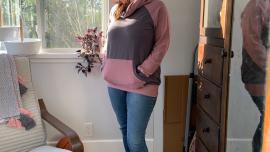 author wearing finished knit sweatshirt