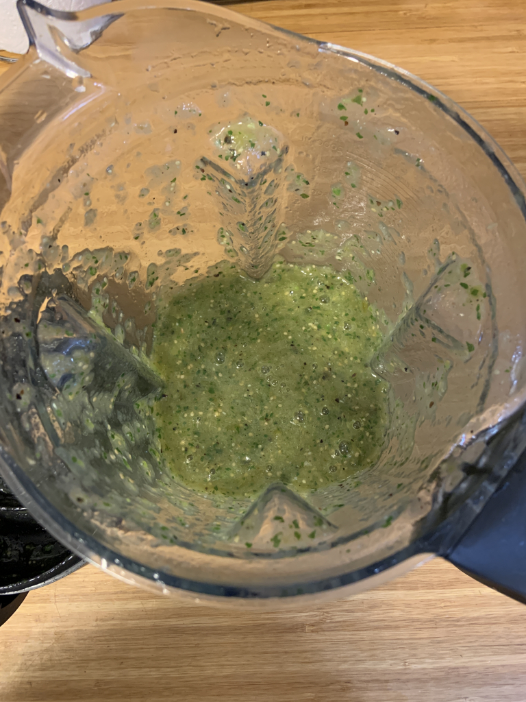 View of all ingredients blended into homemade salsa verde